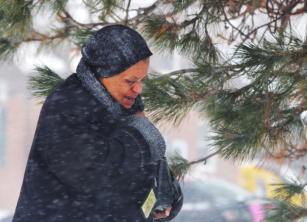 . Michael Allen Blair/MBlair@News-Herald.com Battling high winds and blowing snow, an RTA rider makes her way to a bus station at Shoregate Plaza in Willowick Wednesday.