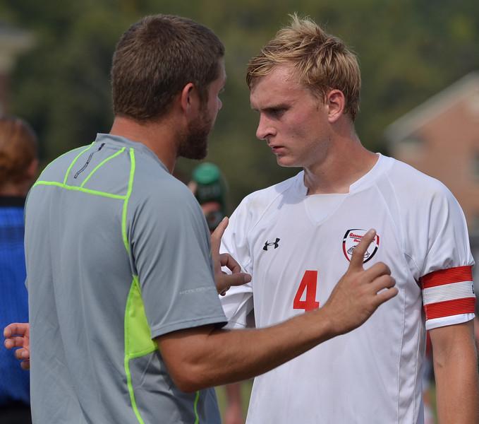 Jon Ole Reinhardsen (4) gets some advice from coach Tyler Kettering.
