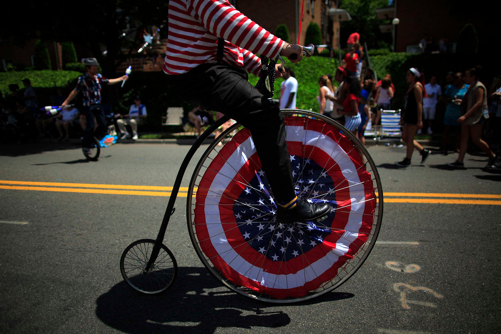 . People take part in an Independence Day parade in Ridgefield Park, New Jersey July 4, 2013. REUTERS/Eric Thayer
