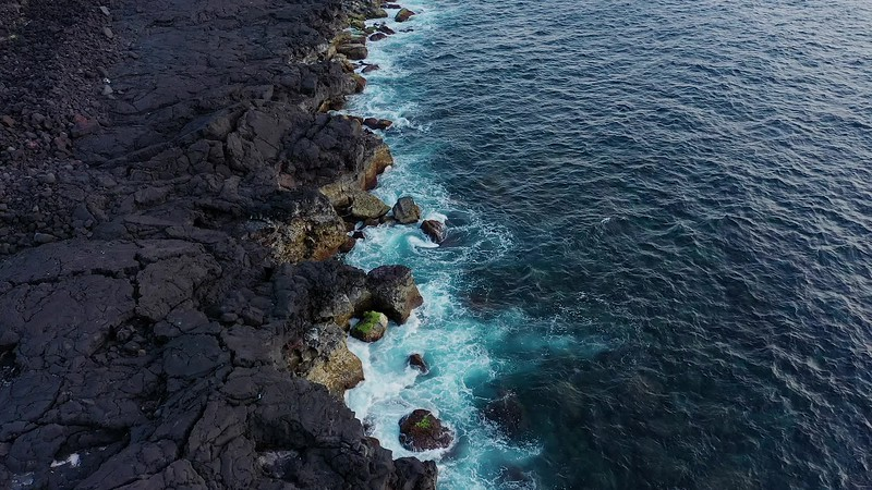 Available in 4K - Aerial image showing the typical black lava basalt coastline of Ilha do Pico Island in the Azores