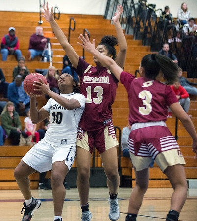 02/13/20 Wesley Bunnell | StaffrrNewington girls basketball defeated New Britain at home Thursday evening. Newington's Ashanti Frazier (10) looks for a shot guarded by Jada Hubbard (13).