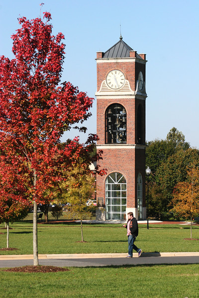 A student walks by the Hollifield Carillon (bell tower) on a Fall day at Gardner-Webb University.