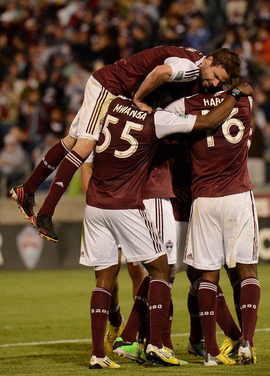 . COMMERCE CITY, CO. - MAY 04 : Colorado Rapids Drew Moor #3, top, Danny Mwanga #55, Atiba Harris #16 and the teammates celebrate winning goal of Edson Buddle #9 in the 2nd half of the game against Toronto FC at Dick\'s Sporting Goods Park in Commerce City, Colorado. May 4, 2013. Colorado won 1-0. (Photo By Hyoung Chang/The Denver Post)