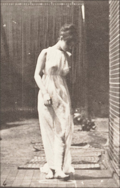 Semi-nude woman walking, turning and stopping to lift train