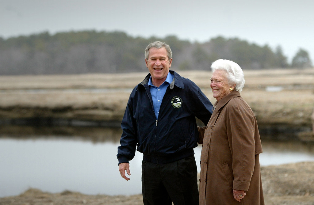 . President Bush shares a laugh with his mother Barbara Bush  on Earth Day at the Wells National Estuarine Research Reserve, Thursday, April 22, 2004, in Wells, Maine.(AP Photo/Lawrence Jackson)