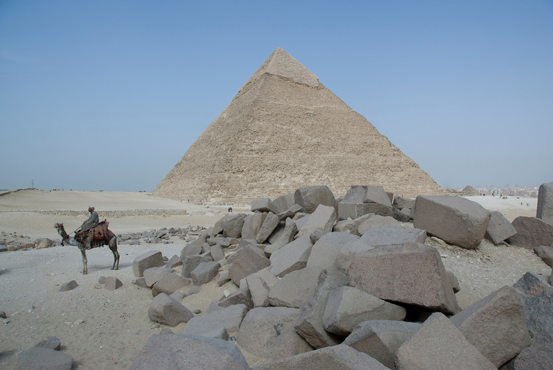 Man riding a camel near the Pyramid - Giza, Egypt