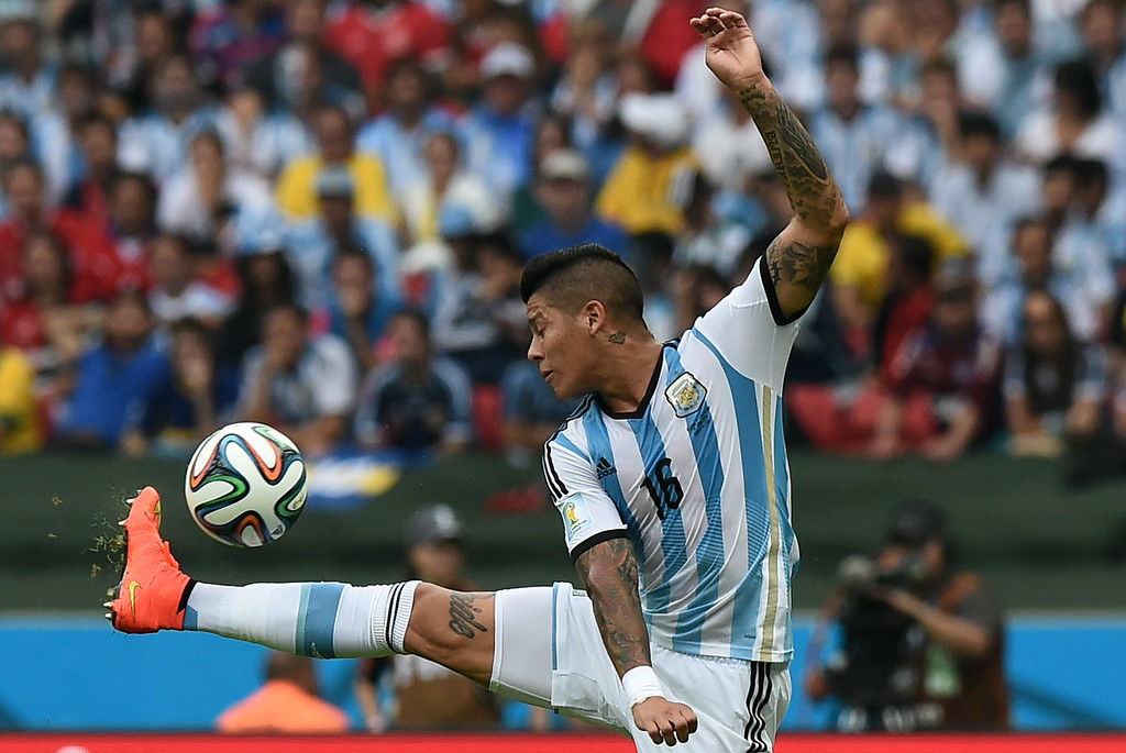 . Argentina\'s defender Marcos Rojo controls the ball during the Group F football match between Nigeria and Argentina at the Beira-Rio Stadium in Porto Alegre on June 25, 2014,during the 2014 FIFA World Cup. JEWEL SAMAD/AFP/Getty Images