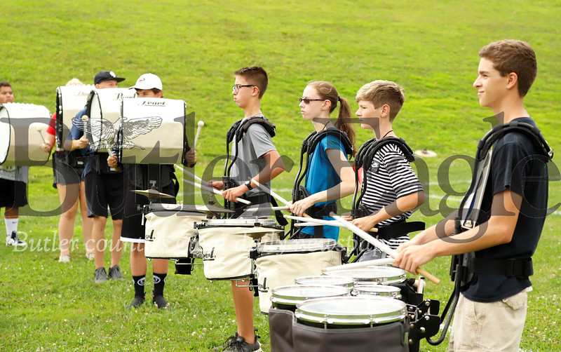 Christian Shaffer(Rright), Nolan Darr, Leah Harris, Jacob Anthony and the percussion section of the Slippery Rock marching band warm up at practice Wednesday. 082119 Sebastian Foltz/Butler Eagle