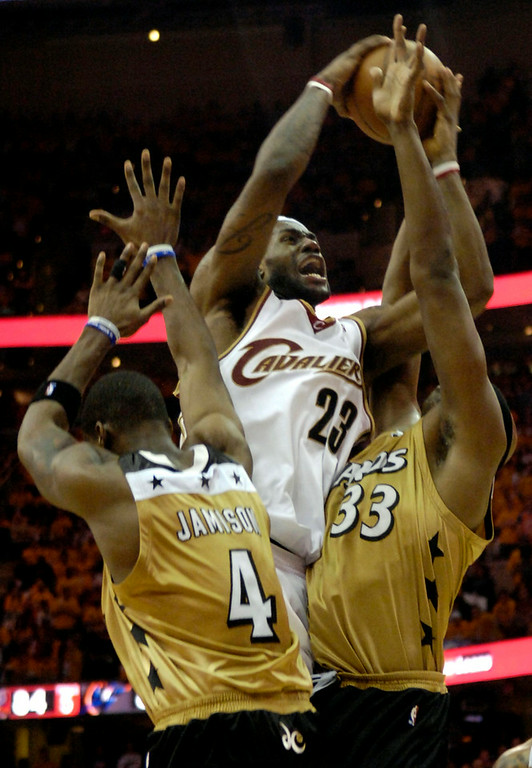 . Michael Blair/MBlair@News-Herald.com LeBron James is fouled by the Wizard\'s Antawn Jamison, left, and Brendan Haywood as he drives to the basket just as the shot clock ticks to one with under two minutes remaining in the fourth quarter.