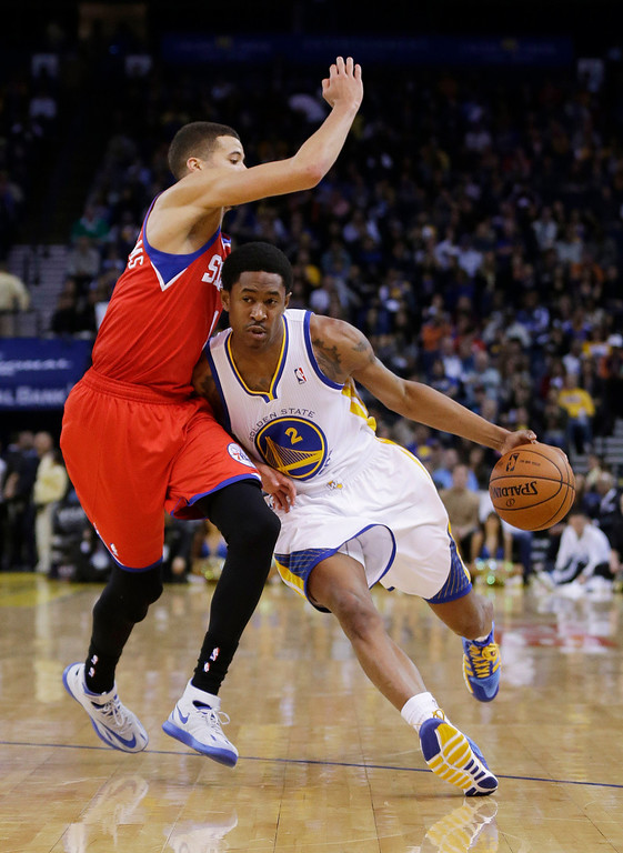 . Golden State Warriors\' MarShon Brooks (2) in action against the Philadelphia 76ers during the second half of an NBA basketball game on Monday, Feb. 10, 2014, in Oakland, Calif. (AP Photo/Marcio Jose Sanchez)