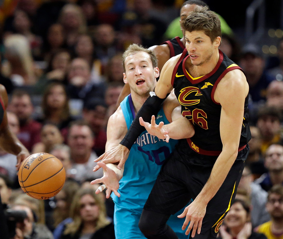 . Charlotte Hornets\' Cody Zeller, left, and Cleveland Cavaliers\' Kyle Korver battle for the ball in the first half of an NBA basketball game, Friday, Nov. 24, 2017, in Cleveland. (AP Photo/Tony Dejak)