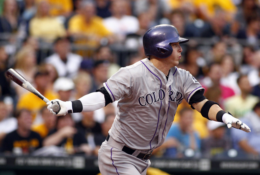 . PITTSBURGH, PA - JULY 18:  Corey Dickerson #6 of the Colorado Rockies grounds into a fielder\'s choice scoring a run in the first inning against the Pittsburgh Pirates during the game at PNC Park on July 18, 2014 in Pittsburgh, Pennsylvania.  (Photo by Justin K. Aller/Getty Images)