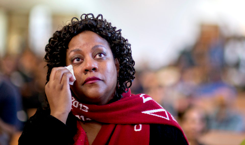 Description of . Herschelle Adams, of Atlanta, wipes away a tear while watching a broadcast of the inauguration of President Barack Obama following the Dr. Martin Luther King Jr. holiday commemorative service at the Ebenezer Baptist Church, Monday, Jan. 21, 2013, in Atlanta. (AP Photo/David Goldman)