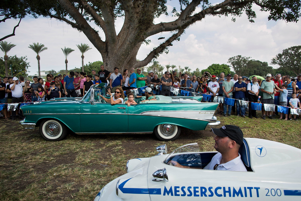 ". Spectators looks at 1957 Chevy Bel Air and 1957 Messerschmitt during the 31st annual ""Five Club\"" car collectors\' meeting in Ramat Gan, Israel, Friday, Oct. 6, 2017. Each weekend, at Israeli gas stations and parking lots and parks, car collectors gather with their beauties _ and take a step back in time. (AP Photo/Oded Balilty)"