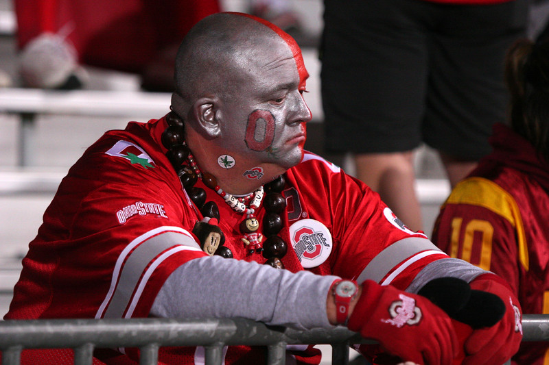 Chris Uhler/Lantern Photographer One Ohio State football fan sits dissapointed by the loss to the University of Southern California, Saturday September 12th 2009, at Ohio Stadium, Columbus, Ohio. Ohio State lost with a final score of 18-15.
