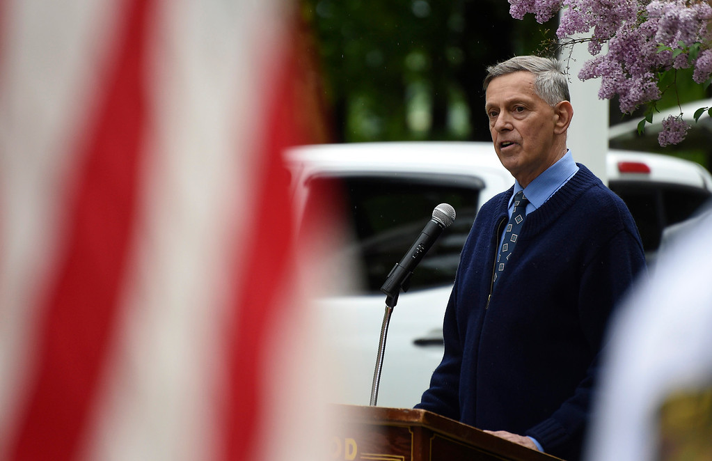 . Kayla Rice/Reformer Guest speaker Dr. Robert Tortolani, a local physician and military service veteran speaks during the Memorial Day service at the Brattleboro Common on Monday morning.