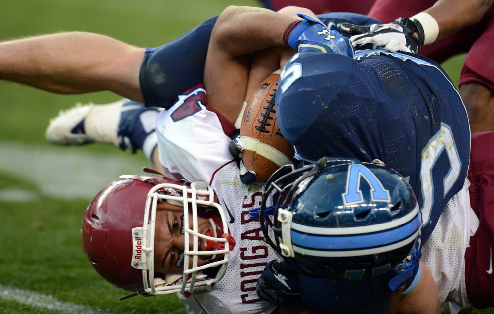 . Cherokee Trail LB D\'Andre Thortvedt, left, tackles Valor Christian RB Christian McCaffrey in the 2nd half of the 5A State Championship game at Sports Authority Field at Mile High on Saturday in Denver, CO on December 1, 2012. Hyoung Chang, The Denver Post