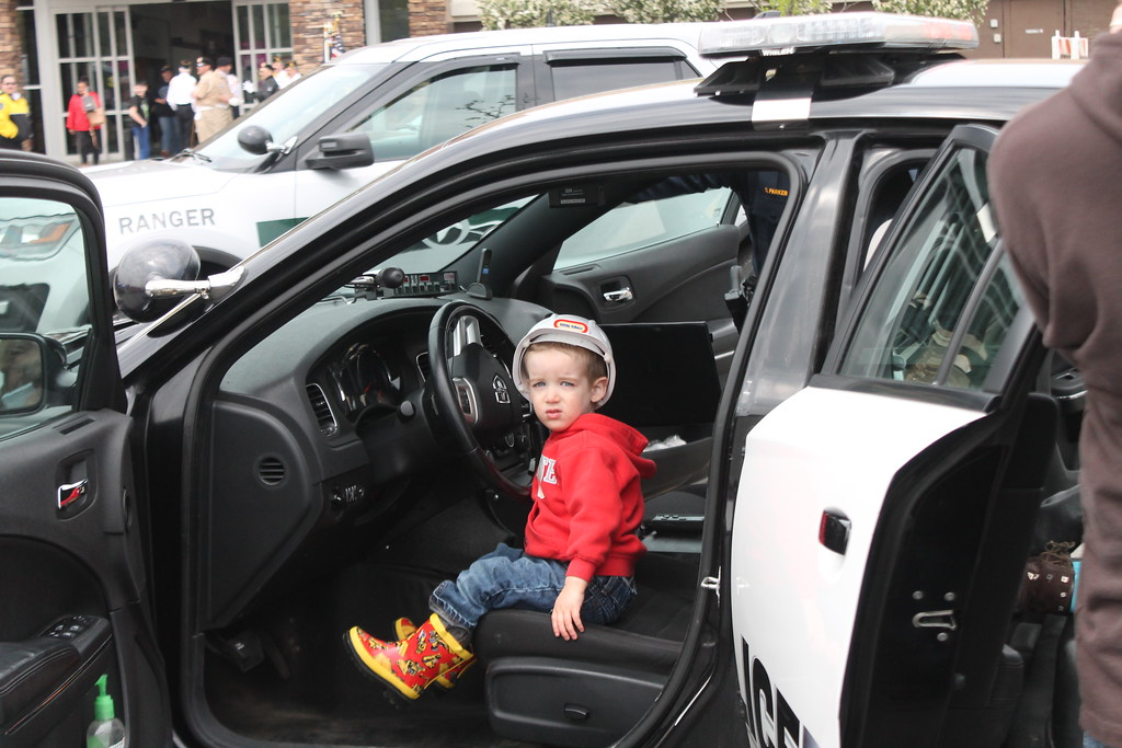 . Kristi Garabrandt � The News-Herald <br> Jonah Lightner, 2, Painesville, sits in a police cruiser from the Eastlake Police Department  during the 36th Annual Heroes Day held at Great Lakes Mall, May 12, 2018.