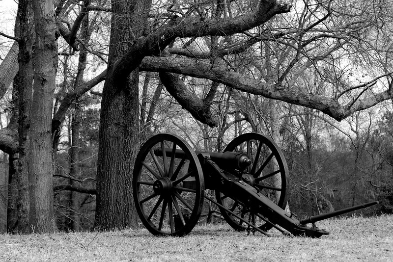 A Parrott Rifle stands on the battlefield, ready for use. The Skirmish at Gamble's Hotel happened on March 5, 1885 when 500 federal soldiers, under the command of Reuben Williams of the 12th Indiana Infantry, marched into Florence to destroy the railroad depot but were met by Confederate soldiers backed up with 400 militia. The reenactment, held by the 23rd South Carolina Infantry, was held at the Rankin Plantation in Florence, South Carolina on Saturday, March 5, 2011. Photo Copyright 2011 Jason Barnette