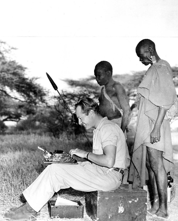 . FEB 19 1950  With no coaching, but plenty of curiosity, two Turkana native trackers look on as Wallace Taber, Denver post outdoor writer, types out his experiences on his current safari in Africa. In a series of thrilling articles starting today, Taber will virtually take you with him to a greatest of all hunting grounds with gun, fishing and camera.   Credit: Denver Post