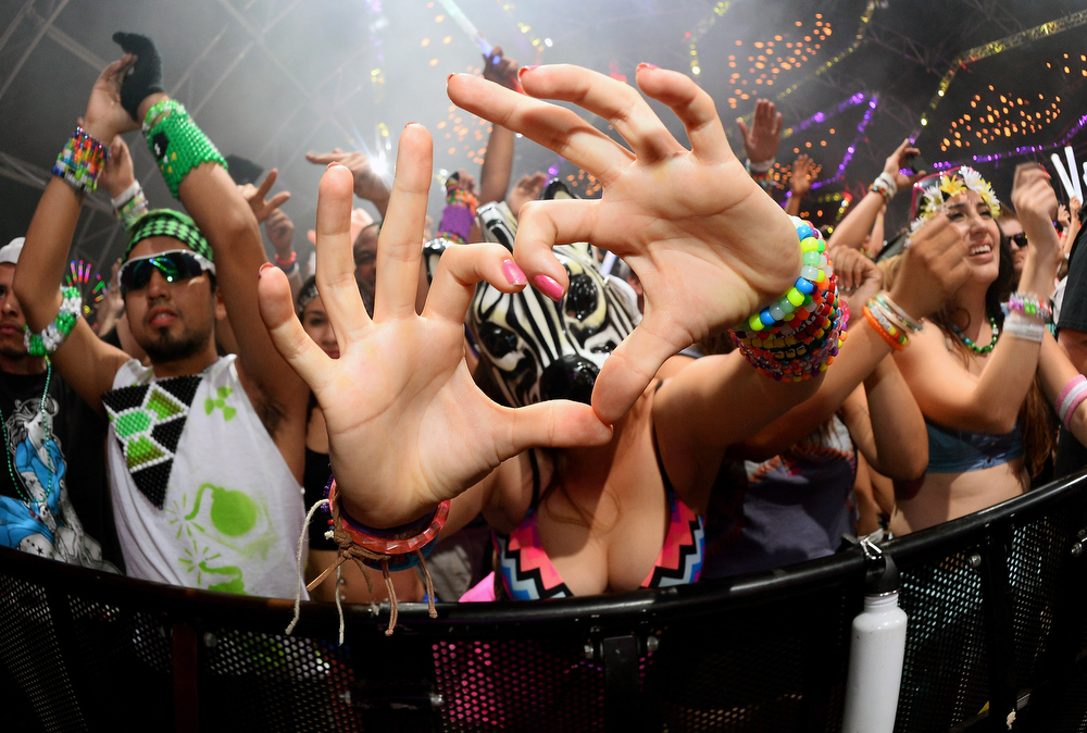 . Daisy Macias of California gestures during a performance by DJs AN21 and Max Vangeli at the 17th annual Electric Daisy Carnival at Las Vegas Motor Speedway on June 23, 2013 in Las Vegas, Nevada.  (Photo by Ethan Miller/Getty Images)