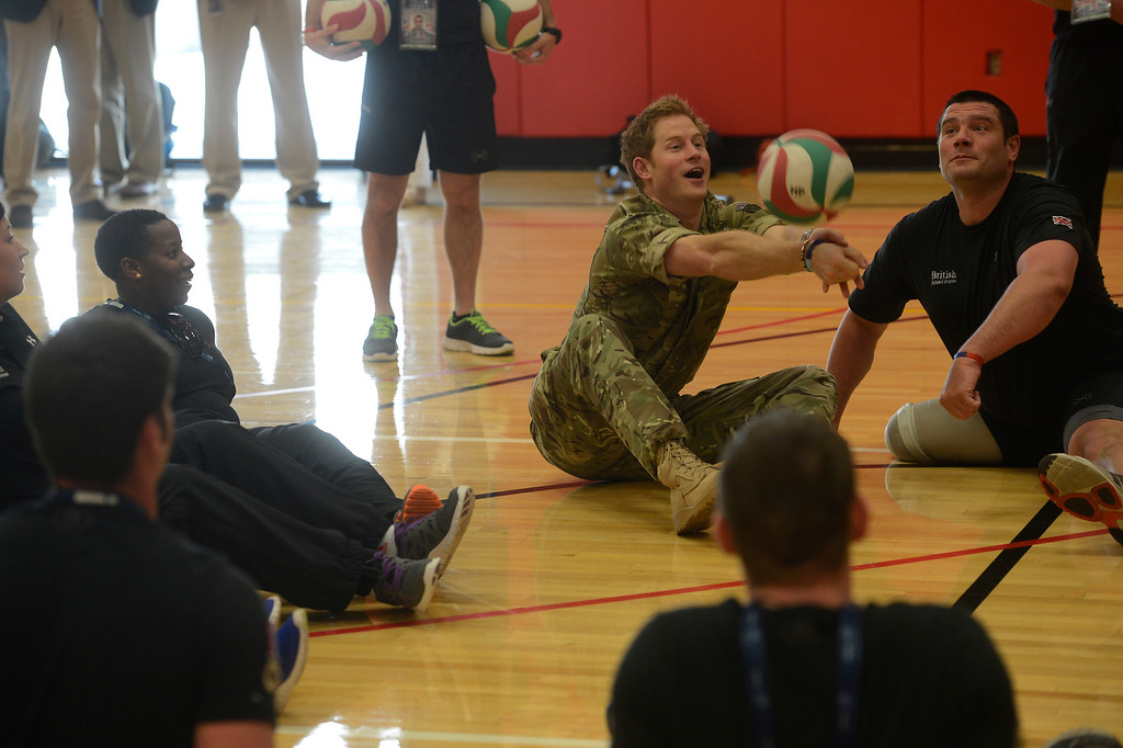 . COLORADO SPRINGS, CO - MAY 11: Britain\'s Prince Harry, hits the volleyball with the British Armed Forces volleyball team members at the United States Olympic Training Center before the opening ceremonies at the 2013 Warrior Games Saturday morning, May 11th, 2013.(Photo By Andy Cross/The Denver Post)