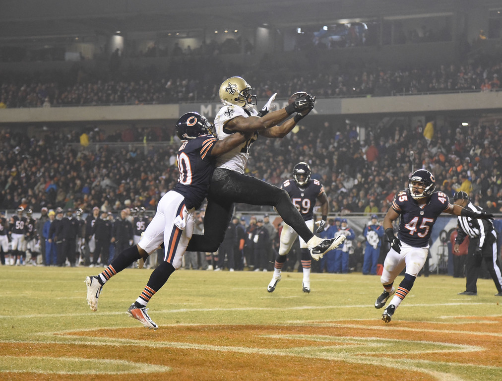 . CHICAGO, IL - DECEMBER 15: Marques Colston #12 of the New Orleans Saints catches a touchdown in front of Demontre Hurst #30 of the Chicago Bears during the second quarter on December 15, 2014 at Soldier Field in Chicago, Illinois.   (Photo by David Banks/Getty Images)