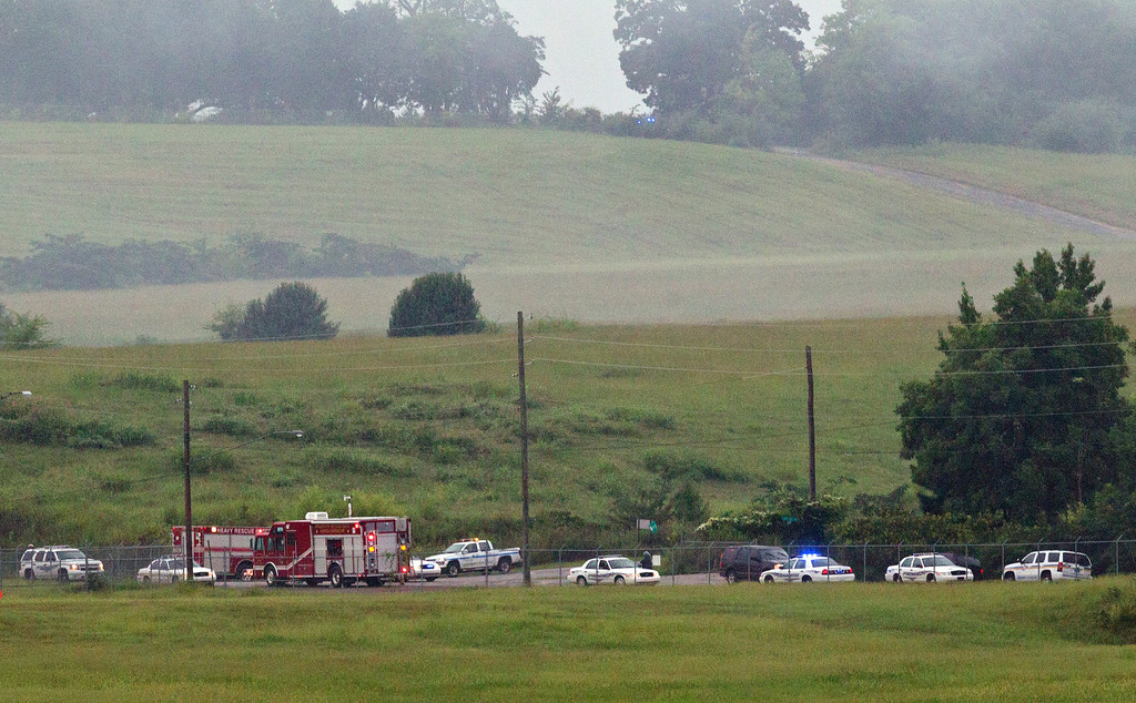 . Fire crews arrive on scene of a plane crash at the Birmingham International Airport in Birmingham, Ala., on Wednesday, Aug. 14, 2013. An airport spokeswoman says the large UPS cargo plane that crashed went down in an open field just outside the airport. (AP Photo/Butch Dill)
