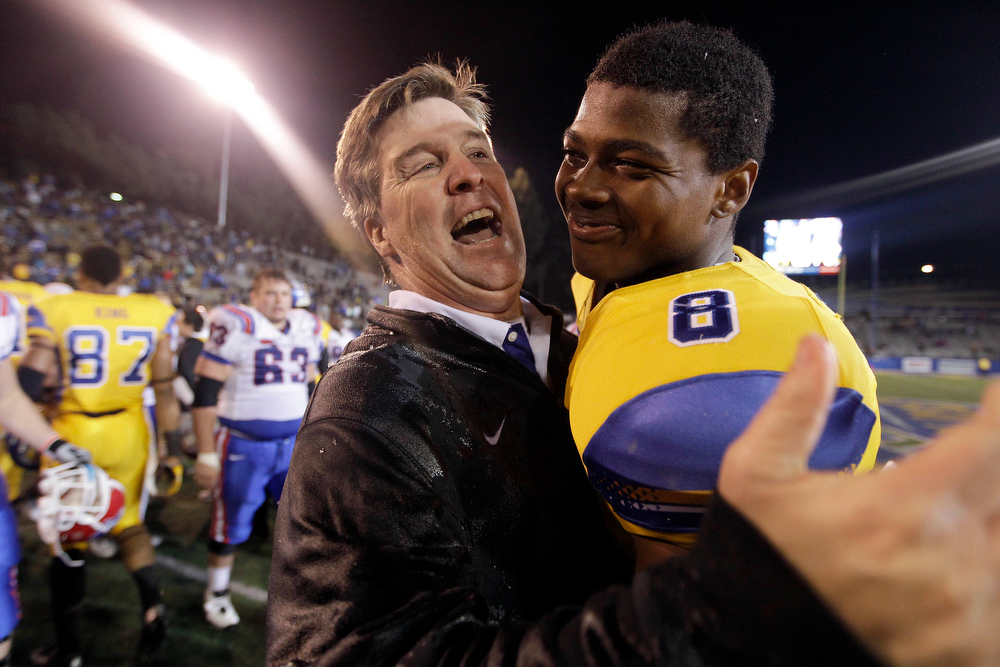 . San Jose State coach Mike MacIntyre  celebrates with cornerback Jimmy Pruitt (8) after their 52-43 win over Louisiana Tech during an NCAA college football game in San Jose, Calif., Saturday, Nov. 24, 2012.(AP Photo/Tony Avelar)