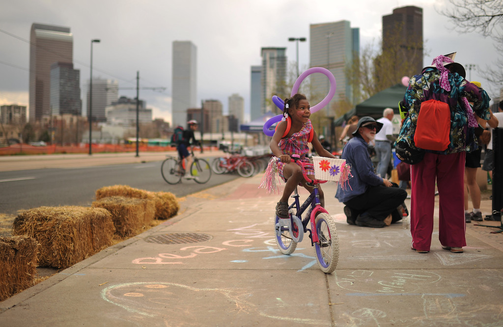 . DENVER, CO. - MAY 11 : Zerry Johnson, 5, rides a bicycle that was fixed by staff members from Groundwork Denver at Five Points in Denver, Colorado. May 11, 2013. People are celebrating the Five Points Better Block Project at Sonny Lawson Park. The event was an opportunity for The Five Points Better Block Project to demonstrate potential improvements for the neighborhood and provide tips to promote a stronger community. (Photo By Hyoung Chang/The Denver Post)