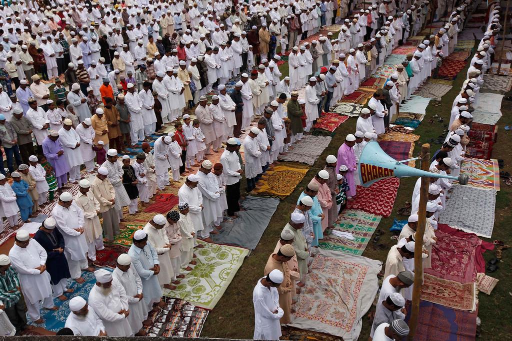 . Indian Muslims offer prayers during Eid al-Adha in Allahabad, India, Wednesday, Oct. 16, 2013.  (AP Photo/Rajesh Kumar Singh)