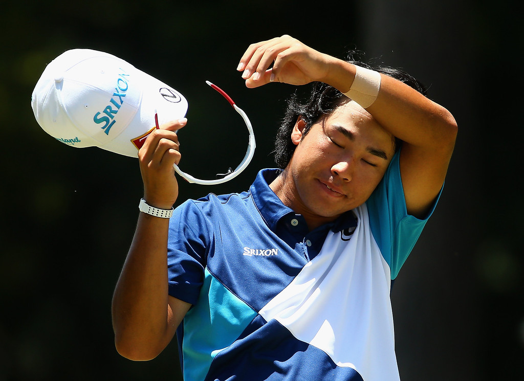 . Hideki Matsuyama of Japan wipes his face on the third hole during the final round of the 114th U.S. Open at Pinehurst Resort & Country Club, Course No. 2 on June 15, 2014 in Pinehurst, North Carolina.  (Photo by Streeter Lecka/Getty Images)