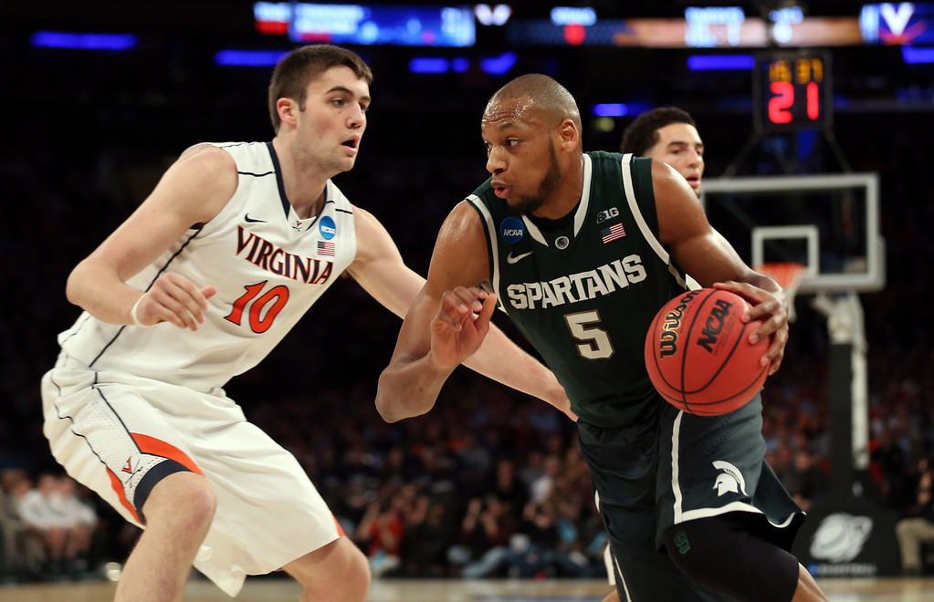 . Adreian Payne #5 of the Michigan State Spartans handles the ball against Mike Tobey #10 of the Virginia Cavaliers during the regional semifinal of the 2014 NCAA Men\'s Basketball Tournament at Madison Square Garden on March 28, 2014 in New York City.  (Photo by Bruce Bennett/Getty Images)