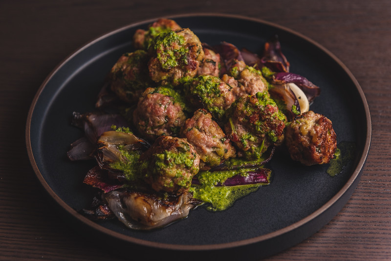 pork meatballs with charred onions and mojo sauce