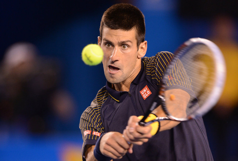 . Serbia\'s Novak Djokovic plays a return during his men\'s singles final against Britain\'s Andy Murray on day fourteen of the Australian Open tennis tournament in Melbourne on January 27, 2013.   GREG WOOD/AFP/Getty Images