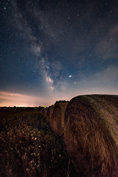 Baled hay under the stars