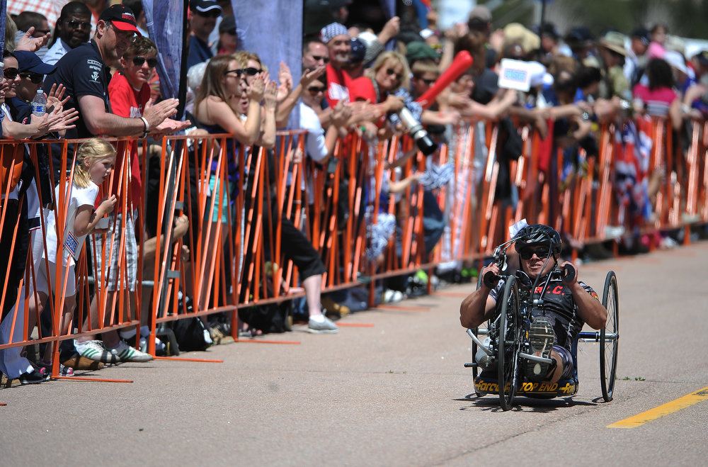 . Marine Eric Rodriquez heads towards the finish line of the Men\'s Handcycle race.  The fourth annual Warrior Games cycling event took started and finished at Falcon Stadium on the grounds of the Air Force Academy in Colorado Springs, CO on May 12, 2013.  HRH Prince Harry was on hand to start the race as well as to hand out medals at the finish line.   A total of 260 wounded, ill and injured service members and veterans came to compete in the week long games.  Members of the Army, Marine Corps, Navy/Coast Guard/Air Force. Special Operations and the British Armed Forces all took part in the competition.  Other events included in the Warrior Games are shooting, sitting volleyball, track & field and wheelchair basketball.  (Photo by Helen H. Richardson/The Denver Post)
