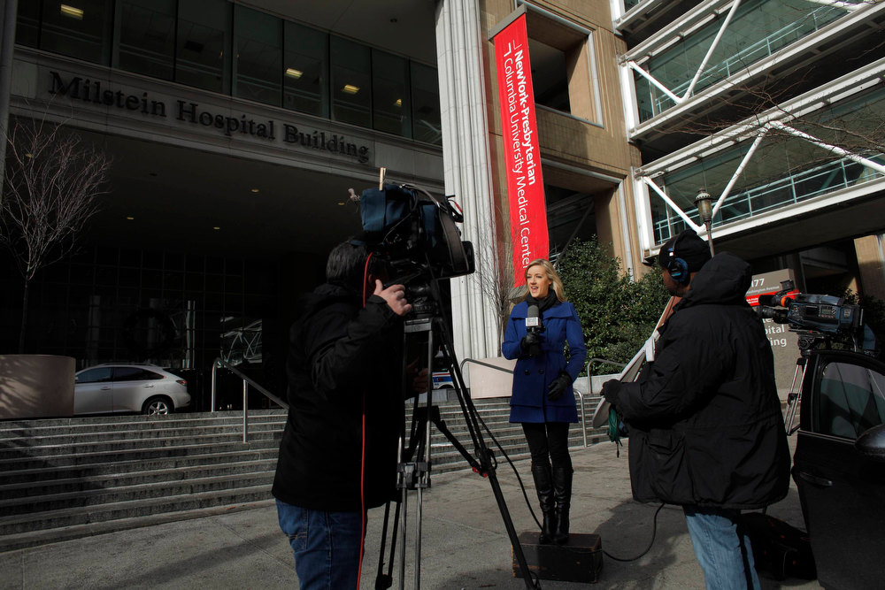 Description of . Media members report in front of the New York-Presbyterian Hospital where U.S. Secretary of State Hillary Clinton was hospitalized in New York, December 31, 2012. Clinton was admitted to a New York hospital on Sunday with a blood clot linked to a concussion she suffered earlier this month, the State Department said in an announcement that looked sure to fuel speculation over the health of one of America's best-known political figures. REUTERS/Eduardo Munoz
