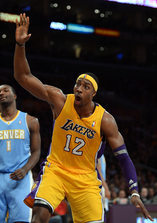 . The Lakers\' Dwight Howard #12 reacts after a big dunk during their game against the Nuggets at the Staples Center in Los Angeles Friday, November 30, 2012.  (Hans Gutknecht/L.A. Daily News)