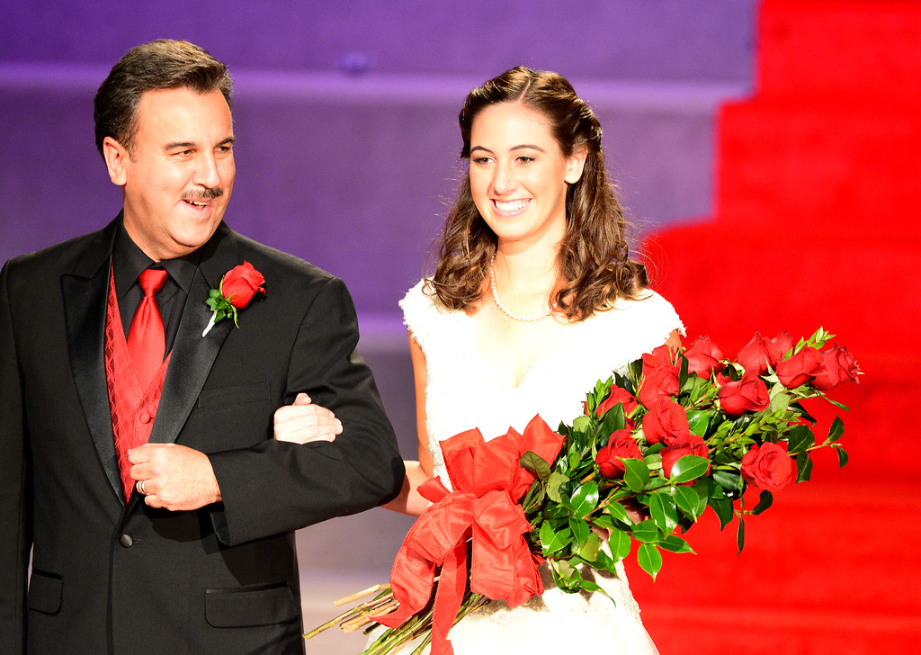 . Ana Acosta is escorted by her father John before being crowned the 96th Rose Queen during the Tournament of Roses\' coronation ceremony Thursday night, October 24, 2013 at the First Church of the Nazarene of Pasadena. (Photo by Sarah Reingewirtz/Pasadena Star-News)
