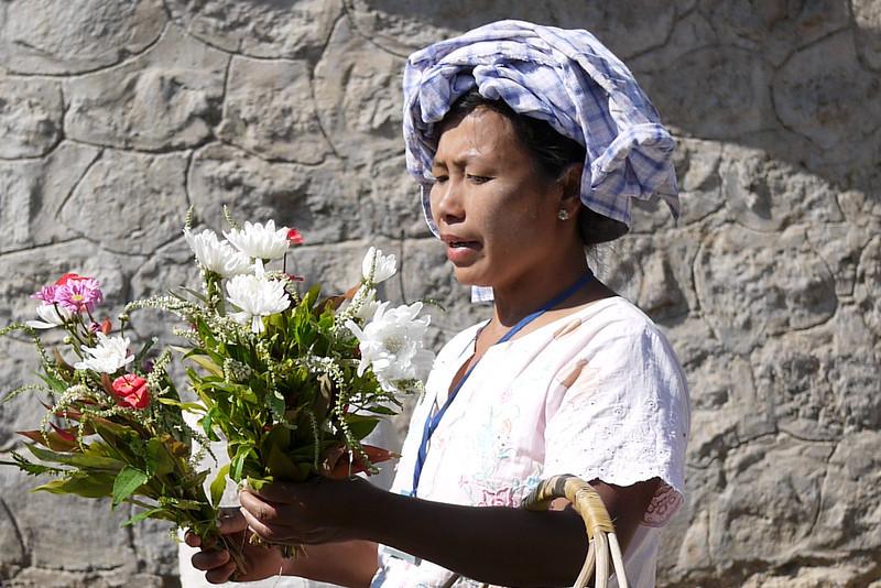 A vendor sells flowers to pilgrims making their way up Mt Popa in Bagan, Burma (Myanmar)