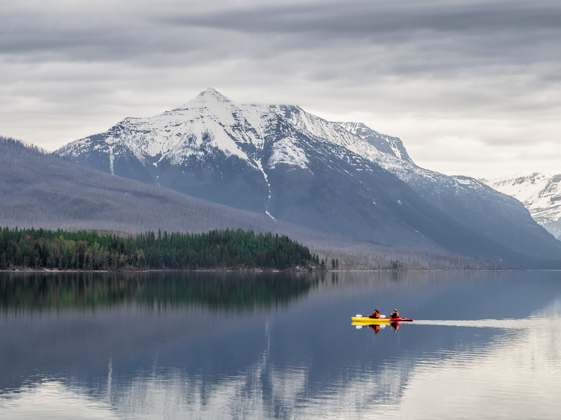 Couple Kayaking in Lake McDonald in Glacier National Park in Early Spring
