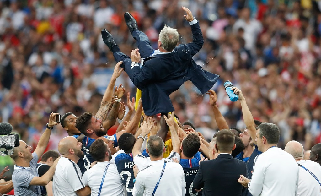 . France head coach Didier Deschamps is thrown in the air at the end of the final match between France and Croatia at the 2018 soccer World Cup in the Luzhniki Stadium in Moscow, Russia, Sunday, July 15, 2018. France won 4-2. (AP Photo/Petr David Josek)