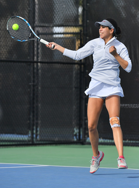 LAS VEGAS, NV - JANUARY 20:  Yadira Rubio of the New Mexico State Aggies plays a forehand during her match against Dominique Beauvais of the Weber State Wildcats at the Frank and Vicki Fertitta Tennis Complex in Las Vegas, Nevada. Rubio won the match 6-2, 6-3.