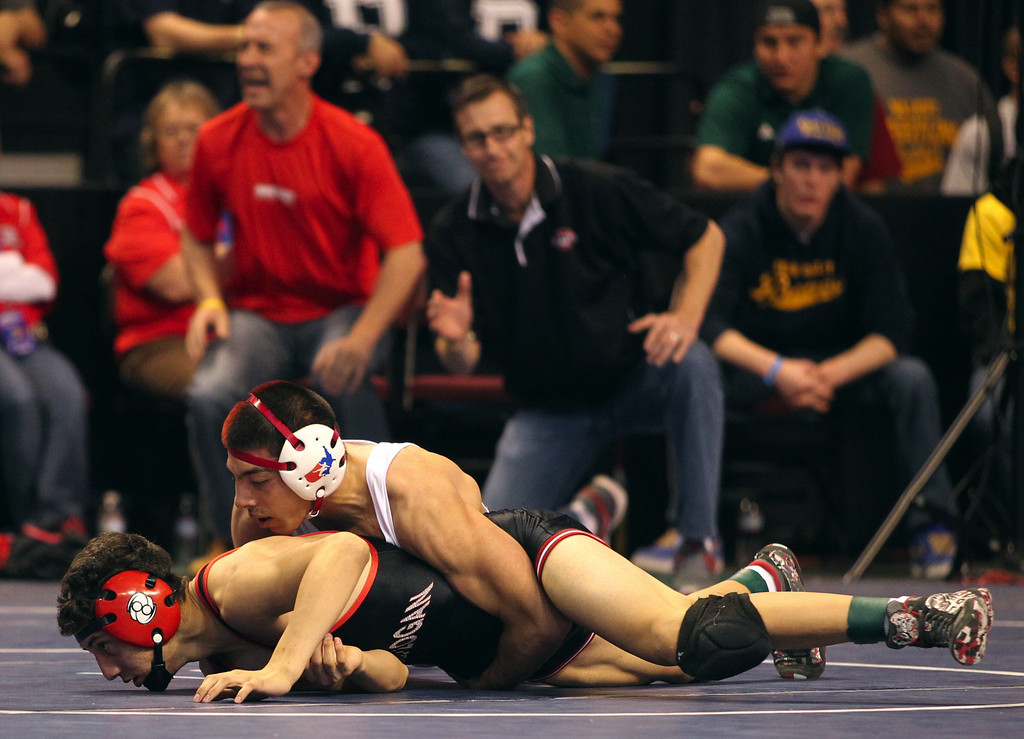 . James Logan\'s Artemio Flores, bottom, wrestles, Bella Vista\'s Victor Trujillo in a 126-pound fifth place match during the California Interscholastic Federation wrestling championships in Bakersfield, Calif., on Saturday, March 2, 2013. Trujillo would go onto win the match. (Anda Chu/Staff)