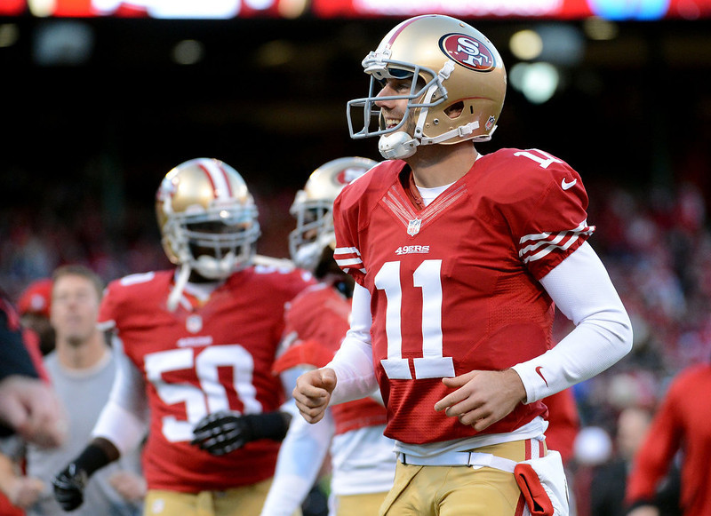 . Quarterback Alex Smith #11 of the San Francisco 49ers looks on during warm ups prior to the NFC Divisional Playoff Game against the Green Bay Packers at Candlestick Park on January 12, 2013 in San Francisco, California.  (Photo by Harry How/Getty Images)
