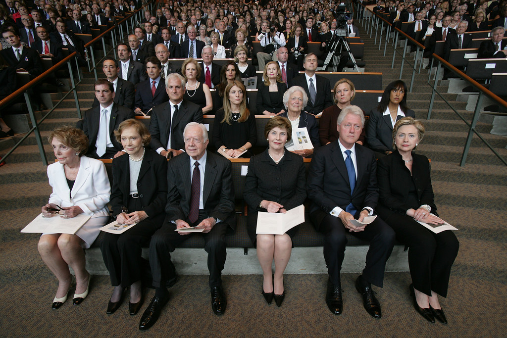 . Dignitaries, including former presidents and first ladies, attend funeral services for Lady Bird Johnson on Saturday, July 14, 2007, in Austin, Texas. In front are, from left, former first lady Nancy Reagan, former first lady Rosalynn Carter, former President Jimmy Carter, first lady Laura Bush, former President Bill Clinton, and Sen. Hillary Rodham Clinton, D-N.Y. In the second row, from left, are a Secret Service agent, Ed Schlossberg, his wife Caroline Kennedy, Barbara Bush, Susan Ford Bales, and another Secret Service agent. In the third row are a Secret Service agent, Texas Gov. Rick Perry, Anita Perry, Maria Shriver, Trisha Nixon Cox, and her husband  Ed Cox. (AP Photo/Rodolfo Gonzalez, Pool)