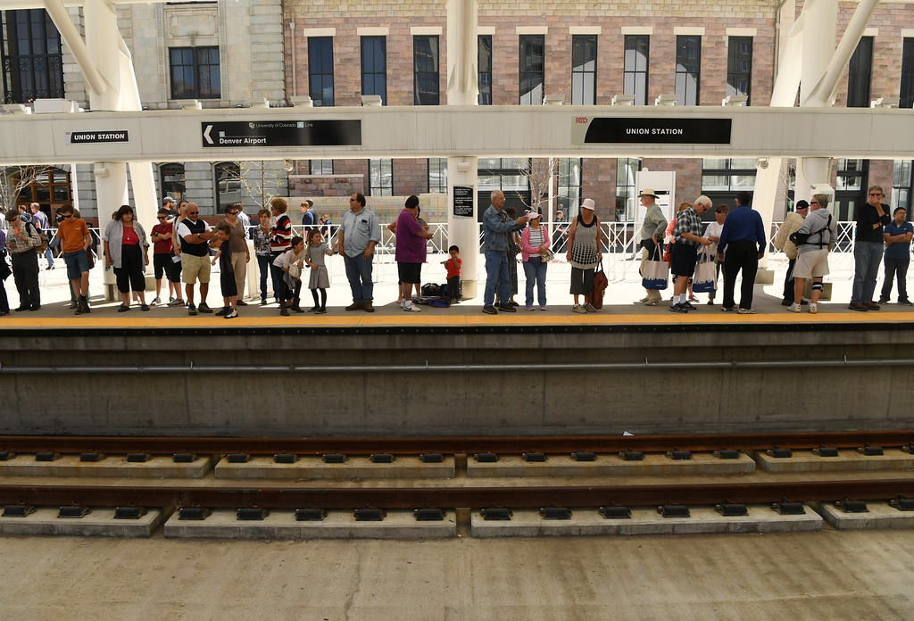 . Riders wait to get on the new University of Colorado A-Line from Union Station to Denver International Airport, April 22, 2016. The line is 23 miles with 8 stations along the way. (Photo by RJ Sangosti/The Denver Post)