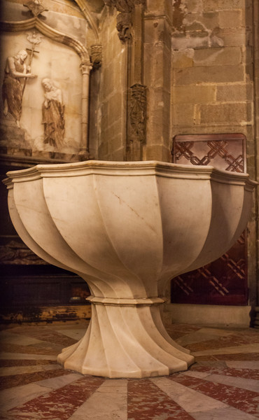 The baptismal font supposedly from the original fourth-century church.
