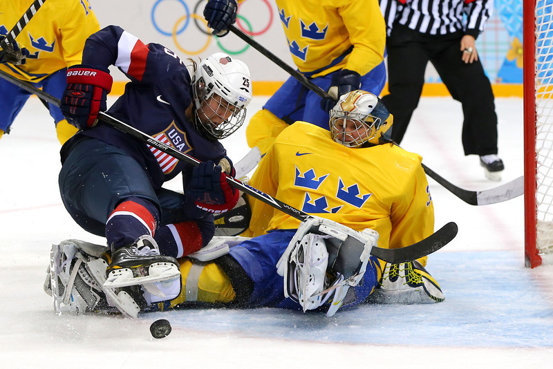 . SOCHI, RUSSIA - FEBRUARY 17: Alex Carpenter #25 of the United States tries to shoot against Valentina Lizana Wallner #35 of Sweden in the second period during the Women\'s Ice Hockey Playoffs Semifinal game on day ten of the Sochi 2014 Winter Olympics at Shayba Arena on February 17, 2014 in Sochi, Russia.  (Photo by Martin Rose/Getty Images)